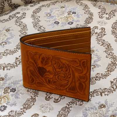 The Emboss Hand-Tooled Leather Bi-Fold Wallet